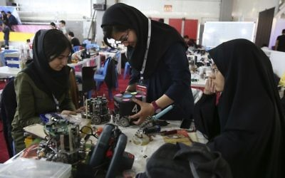 Iranian students prepare their robots during the international robotics competition, RoboCup Iran Open 2016, in Tehran, Iran, April 6, 2016. (AP/Vahid Salemi/File)