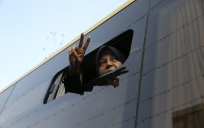 Faezeh Hashemi, daughter of Iran's former President Akbar Hashemi Rafsanjani, who died in January after suffering a heart attack, flashes a victory sign to the crowd from a bus during the funeral ceremony of his father in Tehran, Iran, January 10, 2017. (AP Photo/Vahid Salemi, File)