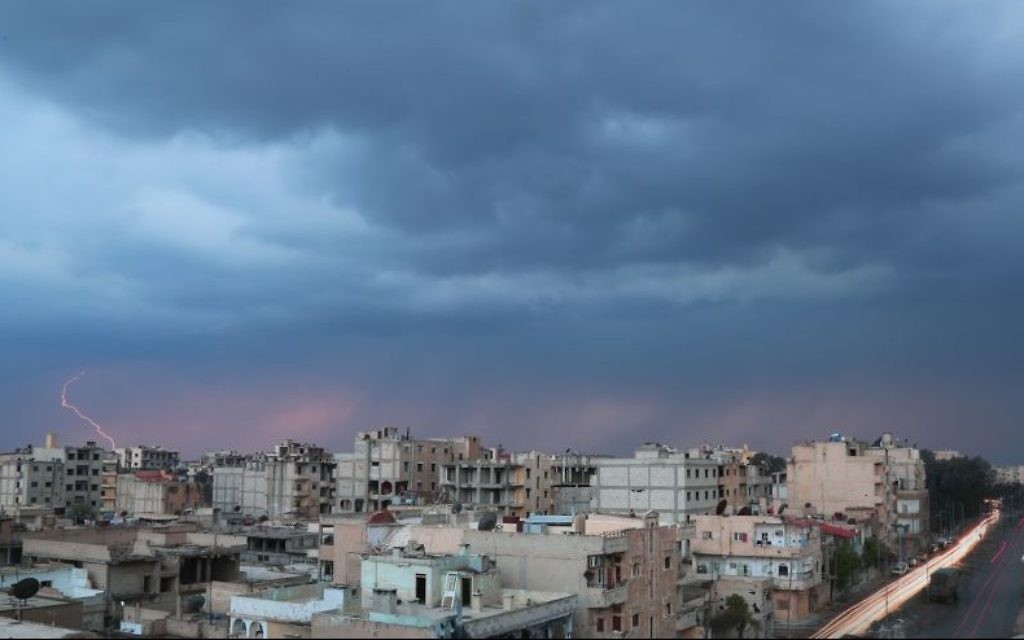 This image released by Islamic State-affiliated Aamaq news agency in March 2017 shows a general view of Raqqa, Syria. (Aamaq news agency via AP)