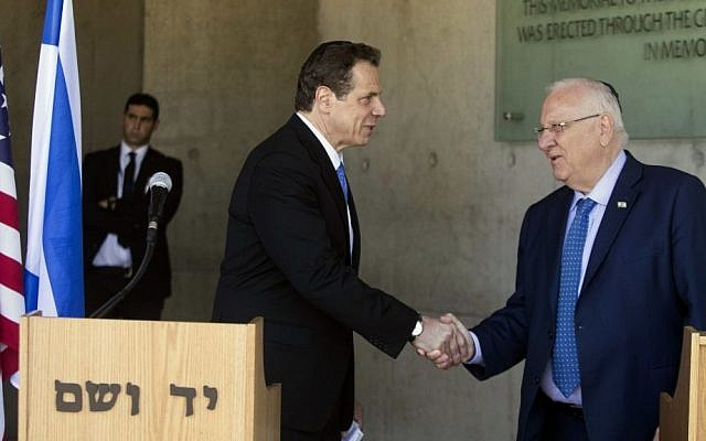The Governor of New York Andrew Cuomo, left, and President Reuven Rivlin shake hands at the Yad Vashem Holocaust memorial, in Jerusalem on March 5, 2017. (AP Photo/Dan Balilty)