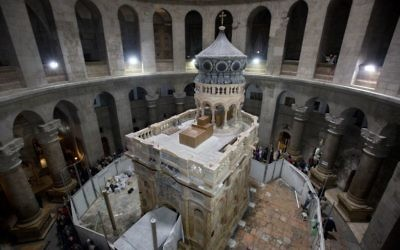 The renovated Edicule is seen in the Church of the Holy Sepulchre, traditionally believed to be the site of the crucifixion of Jesus, in Jerusalem's Old City March 20, 2017. A Greek restoration team has completed a historic renovation of the Edicule, the shrine that tradition says houses the cave where Jesus was buried and rose to heaven. (AP Photo/ Sebastian Scheiner)