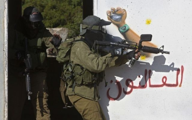 In this Wednesday, March 29, 2017 photo, Israeli soldiers train with paintball guns during a drill at an Army base near Elyakim, Israel. (AP /Sebastian Scheiner)