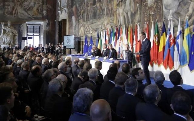European Council President Donald Tusk, panel right, speaks to EU leaders during an EU summit meeting at the Orazi and Curiazi Hall in the Palazzo dei Conservatori in Rome on Saturday, March 25, 2017 (AP Photo/Alessandra Tarantino)