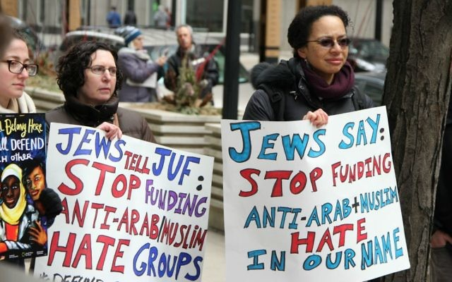 Jewish Voice for Peace members at the Jewish United Fund of Chicago protesting donor-advised funds from JUF going to groups that have been deemed Islamophobic, March 24, 2017. (Inbal Palombo)