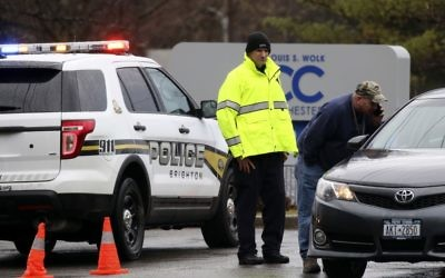 Police officers investigate a bomb threat outside the Louis S. Wolk Jewish Community Center of Greater Rochester in Brighton, NY on Tuesday, March 7, 2017. (Tina Macintyre-Yee/Democrat & Chronicle via AP)