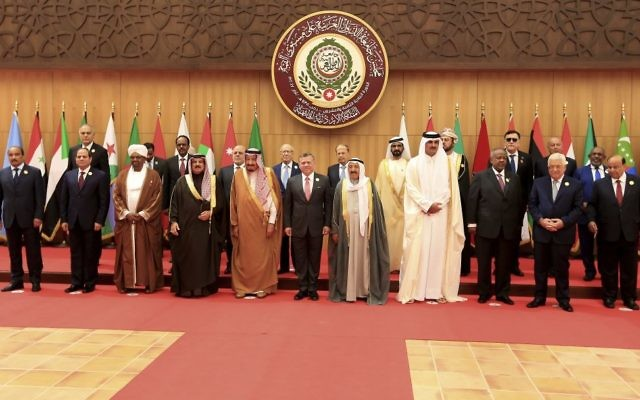 Twenty one kings, presidents and top officials from the Arab League summit pose for a group photo, at a gathering near the Dead Sea in Jordan on Wednesday, March 29, 2017. With the exception of Syria, whose chair sits empty, all Arab states are participating in the annual event aiming to work on regional solutions to conflicts in Yemen, Libya, Iraq and Syria while tackling extremism, poverty and worries over the new American administration. (AP Photo/ Raad Adayleh)
