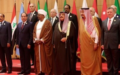 A section of twenty one kings, presidents and top officials from the Arab League summit pose for a group photo, at a gathering near the Dead Sea in Jordan on Wednesday, March 29, 2017. (AP Photo/ Raad Adayleh)