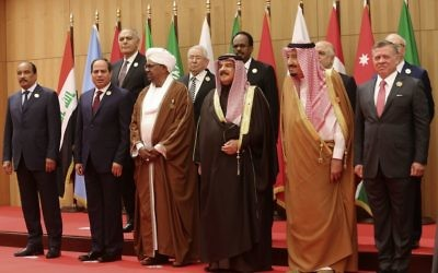 A section of 21 kings, presidents and top officials from the Arab League summit pose for a group photo, at a gathering near the Dead Sea in Jordan on Wednesday, March 29, 2017. (AP Photo/ Raad Adayleh)
