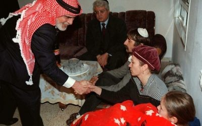 In this Sunday, March 16, 1997 file photo, King Hussein of Jordan shakes the hand of members of the Badayev family in Beit Shemesh who were in mourning after their daughter Shiri was killed by a Jordanian soldier. King Hussein came to Israel to offer condolences to the seven families who lost their daughters in an attack on a class trip. The Jordanian soldier who killed seven Israeli schoolgirls in a 1997 shooting rampage was released Sunday, March 12, 2017, after serving 20 years in prison. (AP PHOTO/GPO/HO, File)