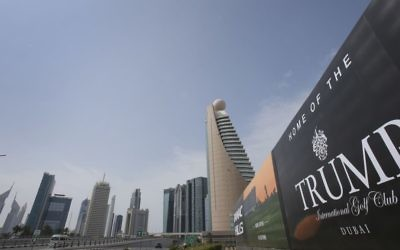 In this Saturday, Feb. 18, 2017 file photo, a giant billboard advertising the Trump International Golf Club hangs at the Dubai Trade Center roundabout, in Dubai, United Arab Emirates. (AP Photo/Kamran Jebreili, File)