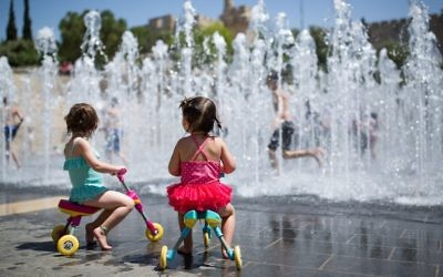 Children playing in a water fountain near the Tower of David in the Old City of Jerusalem, April 17, 2016. (Corinna Kern/Flash90)