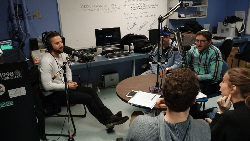 (Left to right) Matan Boni, Benjamin Gottesman, Corey Kamen, Shai Wallach, Elie Fenyes, record their second installment of Radio Gesher. (Dana Wachter/Times of Israel)