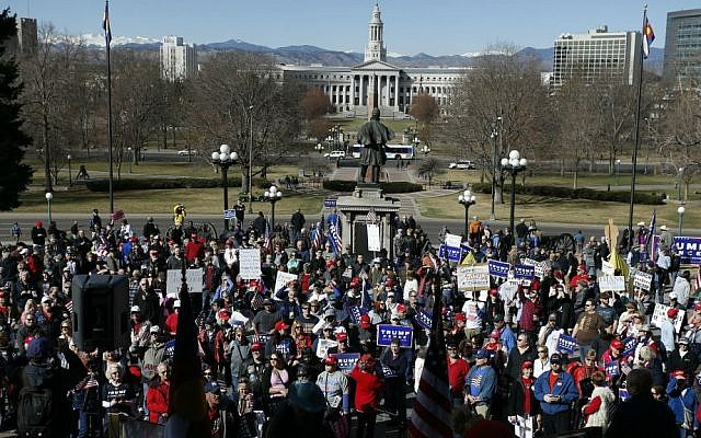 Supporters of US President Donald Trump gather during a March 4 Trump rally on the state Capitol steps in Denver, Colorado, Saturday, March 4, 2017. (AP Photo/Brennan Linsley)