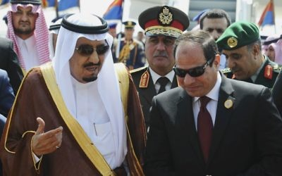 In this March 28, 2015 photo, provided by Egypt's state news agency MENA, Egyptian President Abdel-Fattah el-Sissi, right, talks with Saudi King Salman after the king arrived in Sharm el-Sheikh, Egypt. (MENA via AP,)