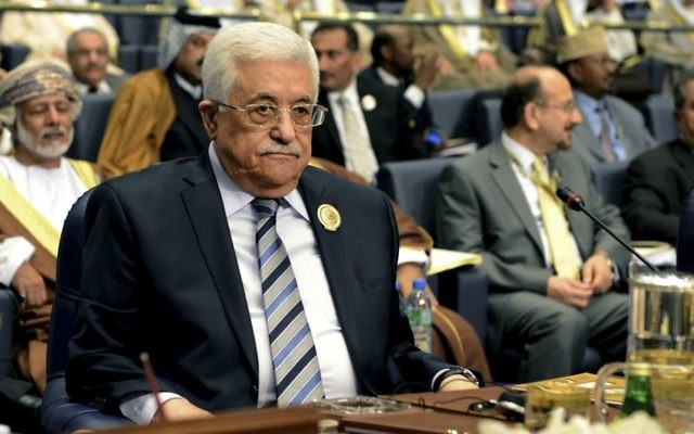 In this March 26, 2014 photo, Palestinian President Mahmoud Abbas attends the closing session of the Arab League Summit at Bayan Palace, Kuwait. (AP Photo/Nasser Waggi)