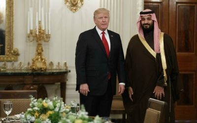In this Tuesday, March 14, 2017 photo, US President Donald Trump stands with Saudi Defense Minister and Deputy Crown Prince Mohammed bin Salman before lunch in the State Dining Room of the White House in Washington.  (AP Photo/Evan Vucci)