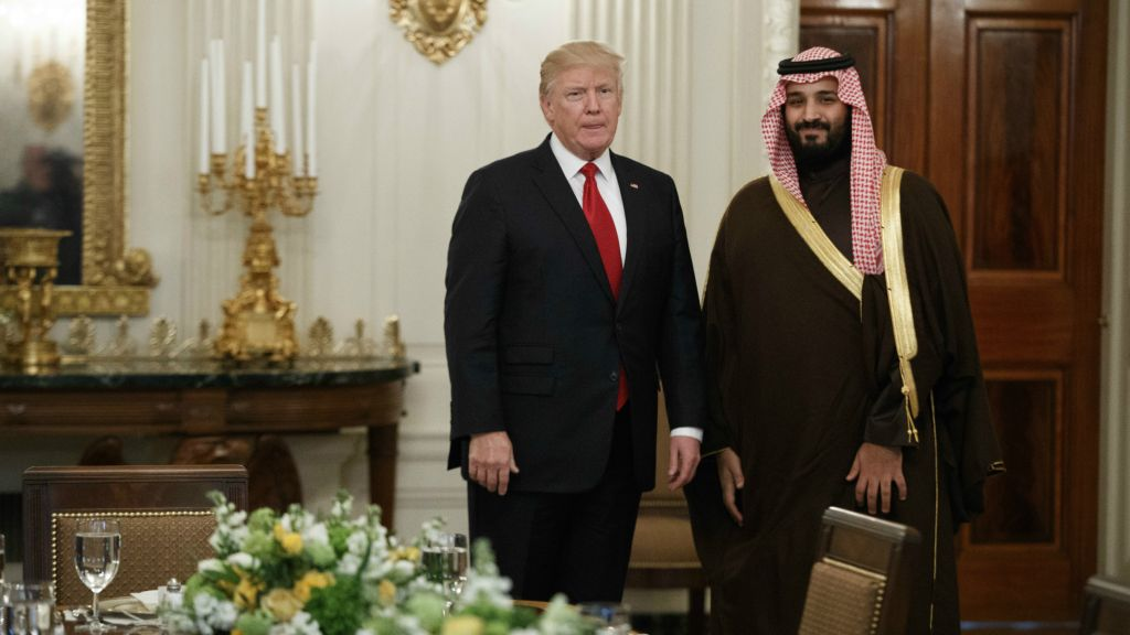 US President Donald Trump stands with Saudi Defense Minister and Deputy Crown Prince Mohammed bin Salman before lunch in the State Dining Room of the White House in Washington, March 14, 2017. (AP Photo/Evan Vucci)