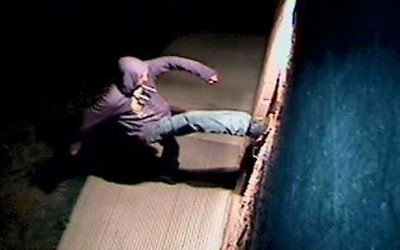 In this Sunday, March 26, 2017, still image from a video surveillance camera, a suspect is shown during the vandalizing of a mosque near Colorado State University in Fort Collins, Colo. (Fort Collins Police Department via AP)
