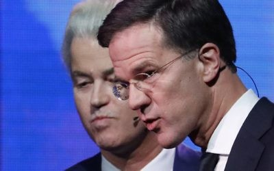 Right-wing populist leader Geert Wilders and Dutch Prime Minister Mark Rutte, right, leave the stage after a national televised debate. (Yves Herman/AP)
