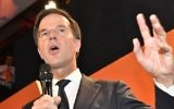 Prime Minister Mark Rutte of the free-market VVD party speaks to his supporters after exit poll results of the parliamentary elections were announced in The Hague, Netherlands, Wednesday, March 15, 2017. (Patrick Post/AP)