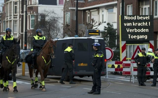 "A sign reads ""Emergency Order, Forbidden To Enter"" as Dutch police block the road leading to the Turkish consul's residence in Rotterdam, Netherlands, Saturday, March 11, 2017. (AP Photo/Peter Dejong)"