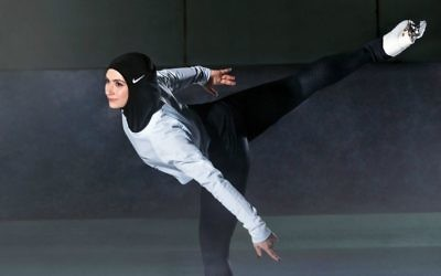 In this undated image provided by Nike, figure skater Zahra Lari models Nike's new hijab for Muslim female athletes. (Nike via AP)