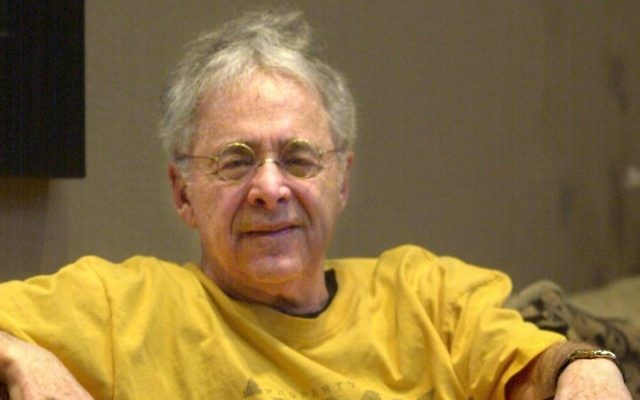 """Chuck Barris, the man behind TV's """"The Dating Game,"""" poses in the lobby of his apartment in New York, Dec. 20, 2002.  (AP Photo/Bebeto Matthews)"""