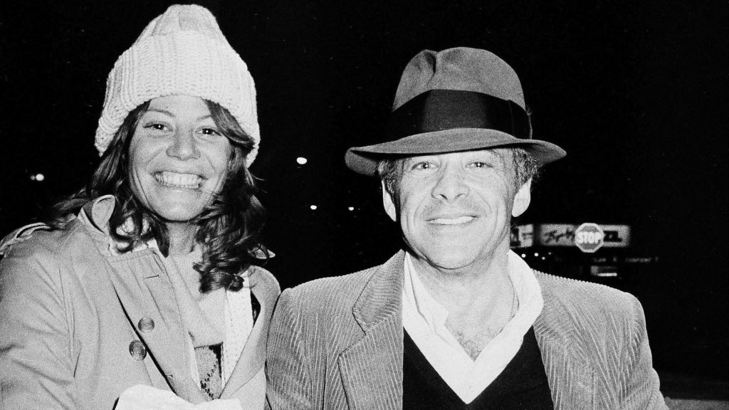 """Chuck Barris, host of the television's """"Gong Show,"""" and Robin Altman leave the Pierre Hotel in New York., Nov. 28, 1980, (AP Photo/Sands)"""