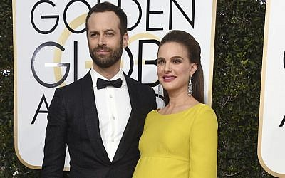 Natalie Portman, right, and her husband Benjamin Millepied, arrive at the 74th annual Golden Globe Awards in Beverly Hills, California, January 8, 2017 (Jordan Strauss/Invision/AP, File)
