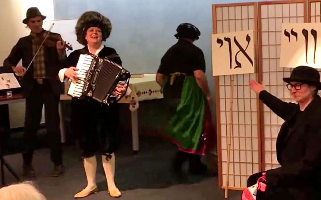 San Francisco-based Yiddish singer Jeanette Lewicki (center) is key to the revival of 1920s drag-performer Pepi Littman. (YouTube screenshot)