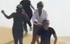Rod Stewart ( in white shirt) seen doing a 'mock execution' of a friend in a parody of Islamic State executions, in a still image from a short Instagram clip posted by Stewart's wife. The singer later apologized for the re-enactment. (Screen capture/ Youtube)