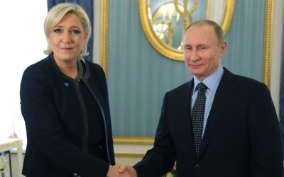 Russian President Vladimir Putin, right, shakes hands with French far-right presidential candidate Marine Le Pen, in the Kremlin in Moscow, Russia, Friday, March 24, 2017. (Mikhail Klimentyev, Sputnik, Kremlin Pool Photo via AP)