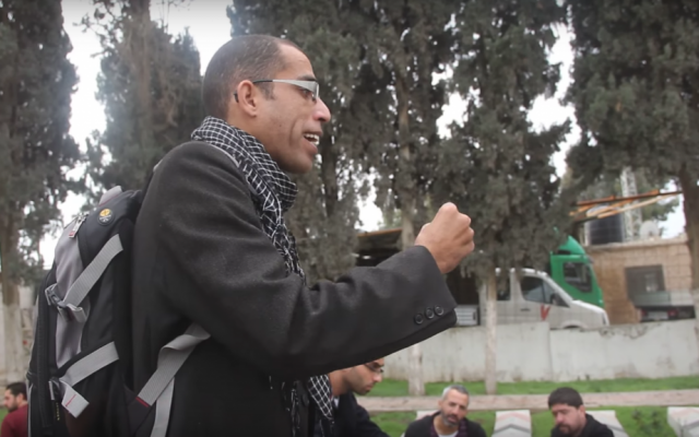 Basel al-A'araj, who was killed in a gunfire exchange with Israeli troops on March 6, 2017, speaks in front of a group at a cemetery in Qabatiya, in the northern West Bank, on December 19, 2014. (Screen capture: YouTube)