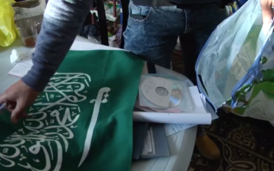 A Hamas flag and other pieces of evidence are collected by police officers from the home of an East Jerusalem assailant who stabbed two police officers on March 13, 2017. (Screen capture/Israel Police)