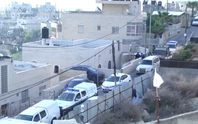 Police raid the home of an East Jerusalem assailant who stabbed two police officers on March 13, 2017. (Screen capture/Israel Police)