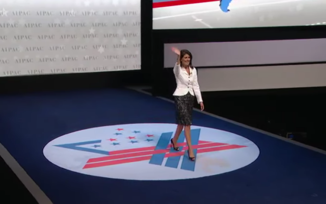 US Ambassador to the UN Nikki Haley acknowledges the applause as she arrives to speak at the AIPAC policy conference in Washington, DC, March 27, 2017 (AIPAC screenshot)