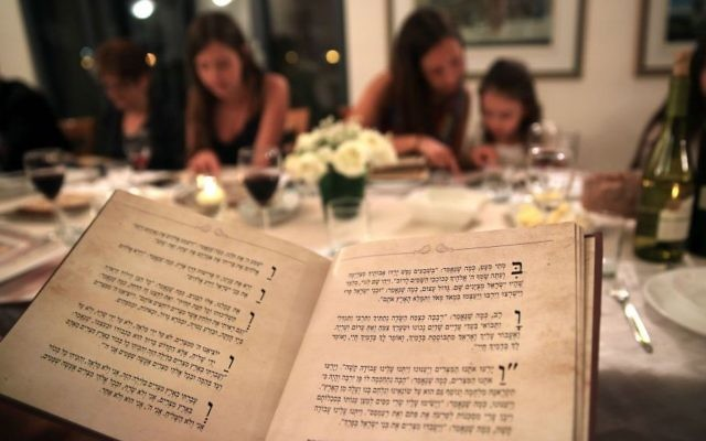 Illustrative: An Israeli family seen during the Passover seder meal on the first night of the eight-day long Jewish holiday, in Tzur Hadassah, on April 22, 2016. (Nati Shohat/ Flash 90)