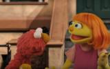 New Sesame Street character Julia (L) with longtime figure of TV show Elmo. (Screen capture: YouTube)