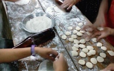 Indian Bnei Menashe Jews baking matzah in Churachandpur, India, March 30, 2017. (Courtesy of Shavei Israel)