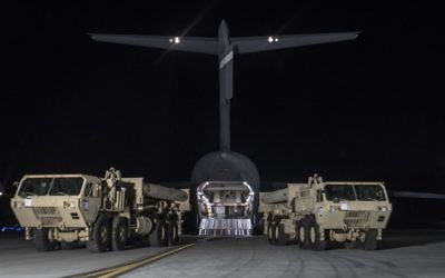 Trucks carrying US missile launchers and other equipment needed to set up the Terminal High Altitude Area Defense (THAAD) missile defense system arrive at the Osan air base in Pyeongtaek, South Korea, Monday, March 6, 2017. (US Force Korea via AP)