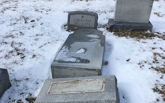 Headstones were toppled at the Waad Hakolel Cemetery, also known as the Stone Road Cemetery, in Rochester, NY. March, 2017 (Courtesy of News 10 NBC WHEC/via JTA)