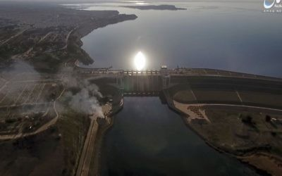 This still image taken from drone footage posted online Monday, March. 27, 2017 shows smoke rising near the Tabqa Dam, in Raqqa, Syria. (Aamaq News Agency via AP)