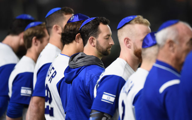 Israel players line up for the national anthem prior to the World Baseball Classic Pool E Game Three between Netherlands and Israel at the Tokyo Dome on March 13, 2017 in Tokyo, Japan. (Photo by Matt Roberts/Getty Images via JTA)