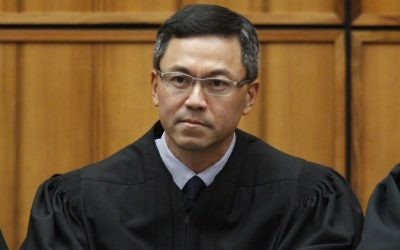 US District Judge Derrick Watson in Honolulu, December 2015 (George Lee/The Star-Advertiser via AP, File)