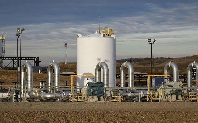 In this Nov. 6, 2015 file photo, TransCanada's Keystone pipeline facilities are seen in Hardisty, Alberta. (Jeff McIntosh/The Canadian Press via AP, File)