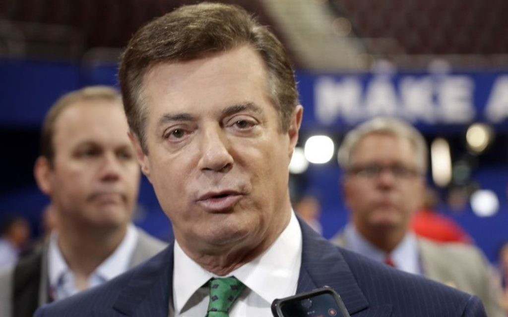 Former Trump campaign chairman Paul Manafort talks to reporters on the floor of the Republican National Convention at Quicken Loans Arena in Cleveland, July 17, 2016. (AP/Matt Rourke)