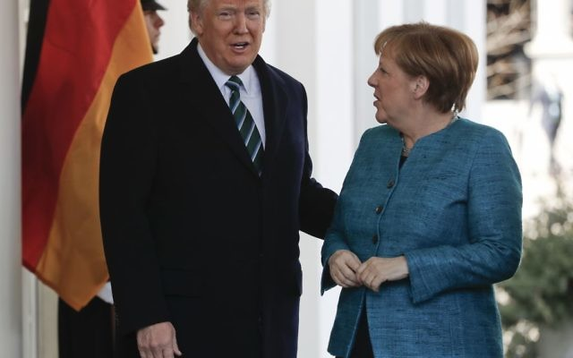 President Donald Trump greets German Chancellor Angela Merkel outside the West Wing of the White House in Washington, Friday, March 17, 2017. (Pablo Martinez Monsivais/AP)
