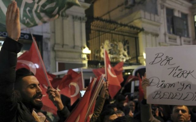 Supporters of Turkey's President Recep Tayyip Erdogan gather outside the Dutch consulate during a protest, in Istanbul, early Sunday, March 12, 2017. (AP Photo)