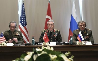 Turkey's Chief of Staff Gen. Hulusi Akar, center, US Chairman of the Joint Chiefs of Staff Gen. Joseph Dunford, left, and Russia's Chief of Staff Gen. Valery Gerasimov attend a meeting in the Mediterranean coastal city of Antalya, Turkey, Tuesday, March 7, 2017. (Turkish Military, Pool Photo via AP)