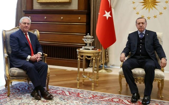 US Secretary of State Rex Tillerson, left, poses with Turkey's President Recep Tayyip Erdogan at the start of their meeting in Ankara, Turkey, Thursday, March 30, 2017. (Presidential Press Service/Pool Photo via AP)
